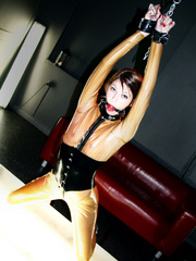 Sexy enslaved babes in tight latex outfit being - Picture 3
