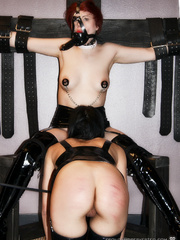 Sexy enslaved babes in tight latex outfit being - Picture 16
