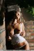 Veronika pushes up her nipples as she imitates…