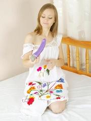 Cute brunette inserts dildo in her - Sexy Women in Lingerie - Picture 1