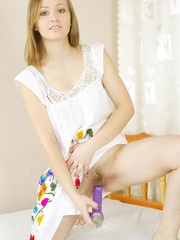 Cute brunette inserts dildo in her - Sexy Women in Lingerie - Picture 2