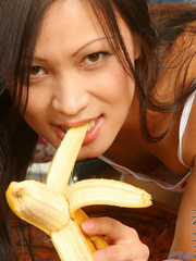 Teen giving a banana blowjob while - Sexy Women in Lingerie - Picture 6