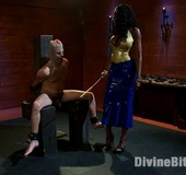 Ebony dominatrix with epic tits bounds her slave…