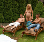 Pregnant blonde spots two guys sunbathing in a…