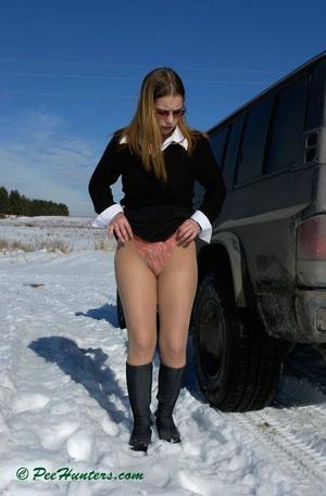 Teen peeing on snow near the car - XXXonXXX - Pic 3