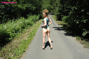 Teeny pissing in the middle of the country road - XXXonXXX - Pic 4