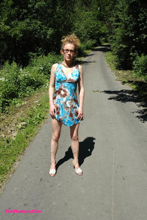Teeny pissing in the middle of the country road - XXXonXXX - Pic 5
