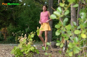 Smooth little sweetie passes water in the woods - XXXonXXX - Pic 1