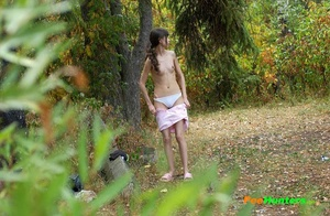 Little babe takes a leak in the nearby bushes - XXXonXXX - Pic 13