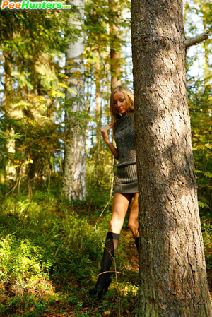 Exciting blonde cutie goes into bushes for a piss - XXXonXXX - Pic 4