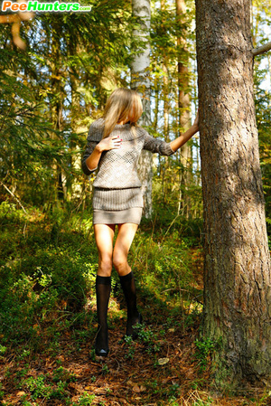 Exciting blonde cutie goes into bushes for a piss - XXXonXXX - Pic 5