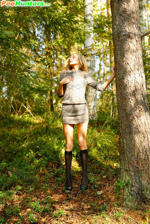 Exciting blonde cutie goes into bushes for a piss - XXXonXXX - Pic 6