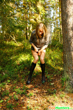 Exciting blonde cutie goes into bushes for a piss - XXXonXXX - Pic 8