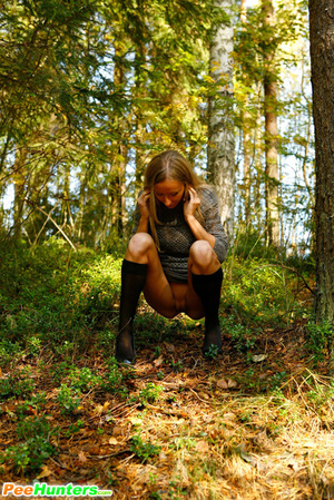 Exciting blonde cutie goes into bushes for a piss - XXXonXXX - Pic 9