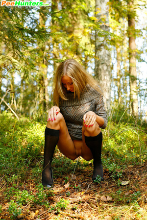 Exciting blonde cutie goes into bushes for a piss - XXXonXXX - Pic 11