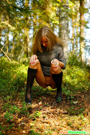 Exciting blonde cutie goes into bushes for a piss - XXXonXXX - Pic 12