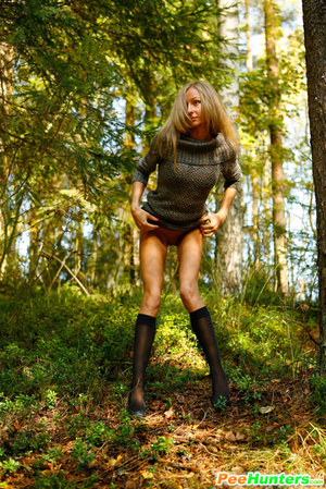 Exciting blonde cutie goes into bushes for a piss - XXXonXXX - Pic 13