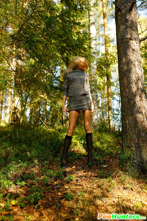 Exciting blonde cutie goes into bushes for a piss - XXXonXXX - Pic 14