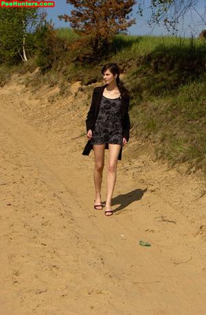Spying on beautiful  teen peeing on the river beach - XXXonXXX - Pic 1