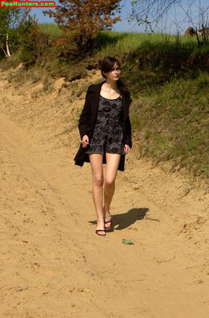 Spying on beautiful  teen peeing on the river beach - XXXonXXX - Pic 2