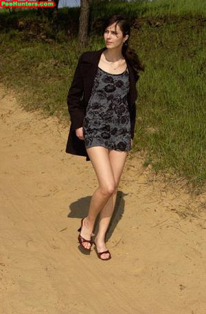 Spying on beautiful  teen peeing on the river beach - XXXonXXX - Pic 3