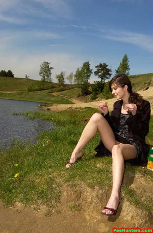 Spying on beautiful  teen peeing on the river beach - XXXonXXX - Pic 10
