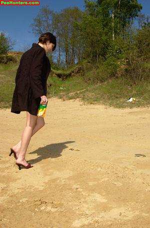 Spying on beautiful  teen peeing on the river beach - XXXonXXX - Pic 16