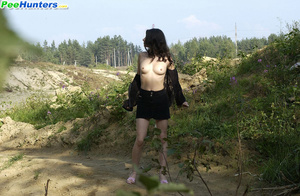 Delicious naked brunette takes a leak in the bush - XXXonXXX - Pic 4