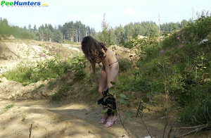 Delicious naked brunette takes a leak in the bush - XXXonXXX - Pic 8