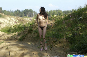 Delicious naked brunette takes a leak in the bush - XXXonXXX - Pic 10