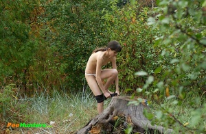 Slim teenage nudist chick caught peeing in bush - XXXonXXX - Pic 15