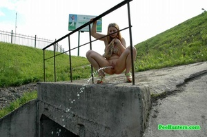 Teenage doll taking a long piss off the bridge - XXXonXXX - Pic 10