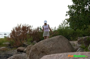 Hot teen smoker piddling off the rock in the park - XXXonXXX - Pic 1