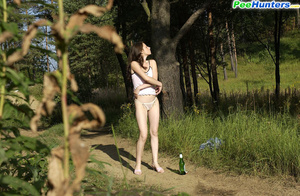 Beautiful kitty plays watersports on a quiet forest glade - XXXonXXX - Pic 7