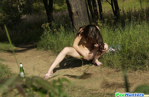 Shameless young tart caught peeing on forest path - XXXonXXX - Pic 7