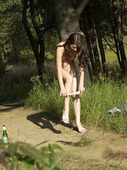 Shameless young tart caught peeing on forest path - XXXonXXX - Pic 8