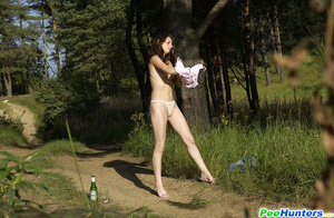 Shameless young tart caught peeing on forest path - XXXonXXX - Pic 11