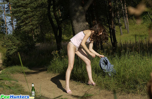 Shameless young tart caught peeing on forest path - XXXonXXX - Pic 12