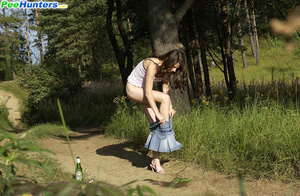 Shameless young tart caught peeing on forest path - XXXonXXX - Pic 13