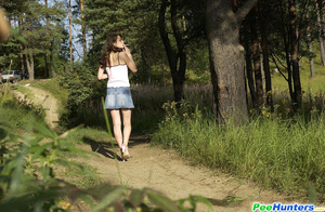 Shameless young tart caught peeing on forest path - XXXonXXX - Pic 15