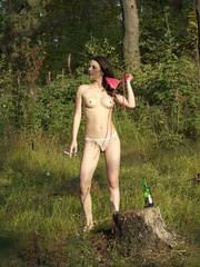 Young nude babe pissing with a cig in her hand - XXXonXXX - Pic 8