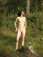 Young nude babe pissing with a cig in her hand - XXXonXXX - Pic 9