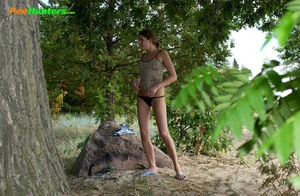 Young swarthy babe pisses sitting on the rock - XXXonXXX - Pic 3