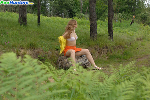 Kinky beauty makes piddle while sitting on a log - XXXonXXX - Pic 6