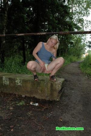 Nasty blonde teeny pissing in a quiet park - XXXonXXX - Pic 9