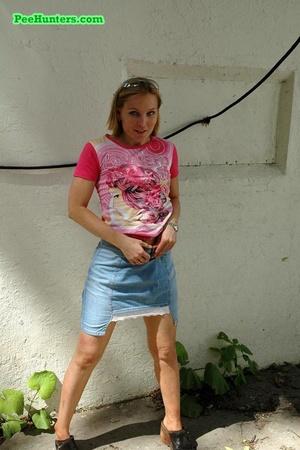 Nasty teen slut takes a piss in the backstreet - XXXonXXX - Pic 1
