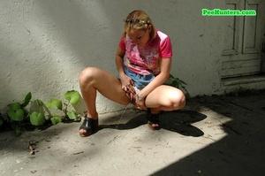 Nasty teen slut takes a piss in the backstreet - XXXonXXX - Pic 4