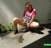 Nasty teen slut takes a piss in the backstreet