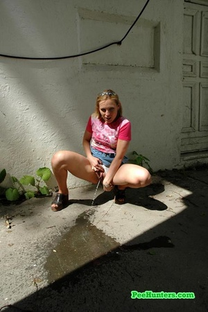 Nasty teen slut takes a piss in the backstreet - XXXonXXX - Pic 7
