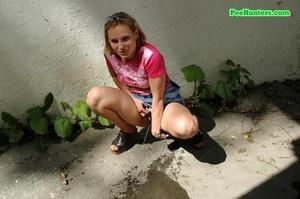 Nasty teen slut takes a piss in the backstreet - XXXonXXX - Pic 12